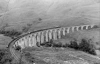 View east over Glenfinnan Viaduct in 1961. The train is the 5.40pm from Mallaig, complete with observation car. <br><br>[David Stewart&nbsp;//1961]