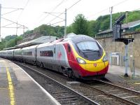 A Glasgow - Euston Pendolino draws away from Oxenholme on 29 May 2014.<br><br>[Bill Roberton&nbsp;29/05/2014]