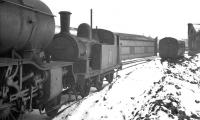 J77 0-6-0T no 68431 standing in the snow on Darlington shed in March 1960. The locomotive had been withdrawn from York on the last day of February and was cut up in the nearby works by the end of the following month. The long shed in the background housed the Darlington breakdown crane.<br><br>[K A Gray&nbsp;//1960]