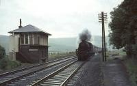 Looking south through the remains of Crawford station on 10 July 1965, just 6 months after closure. The train approaching is a down CTAC special hauled by Black 5 no 44798.<br><br>[John Robin&nbsp;10/07/1965]
