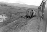 Aftermath of a derailment photographed from a train crossing Rannoch Moor on 6 September 1961. The mishap had occurred several days earlier resulting in a large number of sleepers being torn up. The van had carried alumina.    <br><br>[David Stewart&nbsp;06/09/1961]