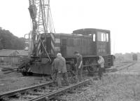 Contractors carrying out track lifting and recovery work between Kelso and Tweedmouth on 26 August 1969. NBL 0-4-0DH D2720 is in the process of being lifted onto the line near Kelso.<br><br>[Bruce McCartney&nbsp;26/08/1969]