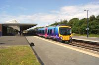 TransPennine 185120 departs from Barrow-in-Furness on 14 June 2014 with a service to Manchester Airport.<br><br>[John McIntyre&nbsp;14/06/2014]