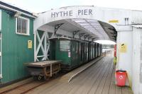 Hythe Pier Head, showing a train under the overall roof. The flat truck is used to carry bags and bulky items and behind that is the <I>Driving Trailer</I>, two further coaches (all with wooden slatted seats) and the electric loco. The pedestrian ramp to the Solent Ferry is just behind the camera. <br><br>[Mark Bartlett&nbsp;25/05/2014]