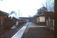 Looking along a deserted platform at East Kilbride in April 1966 with a train of empty stock standing on the left. The line straight ahead to Hunthill Junction, Blantyre, closed as a through route as long ago as 1937 although the section serving the Mavor & Coulson sidings survived until 1966. [See image 19680]<br><br>[G W Robin&nbsp;/04/1966]
