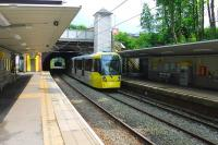 Metrolink 3042, on a service to Bury, leaves the Heaton Park tunnels and rolls into the station of the same name. Outside the station is the park itself which contains an operational preserved tramline.<br><br>[Mark Bartlett&nbsp;09/06/2014]
