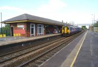 An eastbound service calls at St Helens Junction on 19 April 2014. It may no longer be a junction station but at least it retains a platform building (original?)<br><br>[John McIntyre&nbsp;19/04/2014]