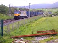 A long way from the Channel Tunnel - 92037 heading South with containers past an NR acess point on 23rd May.<br><br>[Ken Strachan&nbsp;23/05/2014]