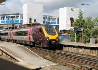 The four tracks at Brockenhurst serve two island platforms, only accessible by footbridges. Major work to install lifts was underway on 25 May 2014 as Voyager 220010 called on a service from Bournemouth heading for Manchester. <br><br>[Mark Bartlett&nbsp;25/05/2014]