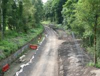 The Waverley trackbed in June 2014 looking south from the A6106 bridge towards Eskbank. [See image 38706]<br><br>[John Furnevel&nbsp;22/06/2014]