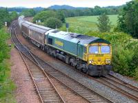 Freightliner 66622 passes Inverkeithing East Junction with Aberdeen - Oxwellmains empties on 24 June.  The two cargowaggons were used for bagged cement.<br><br>[Bill Roberton&nbsp;24/06/2014]