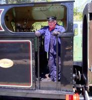 This chap seems to be quite happy driving a steam engine on the Stainmore line [see image 47625]. Wouldn't you be?<br><br>[Ken Strachan 17/05/2014]