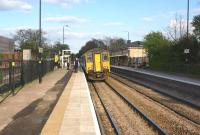 150273 calls at Huyton with a Liverpool to Manchester service on 19 April 2014. On the left work is underway to eventually restore 4 track working from Roby to Huyton Jct just to the east of the station.<br><br>[John McIntyre&nbsp;19/04/2014]