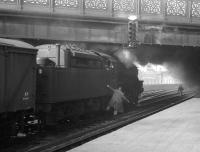 An unidentified Black 5 stands in the west sidings at Carlisle station with a freight, thought to have been photographed on 7 March 1964. The locomotive was one of four examples of the class equipped with self weighing tenders (of which 45081 was allocated to Kingmoor shed at that time). [With thanks to Bill Jamieson]   <br><br>[K A Gray&nbsp;07/03/1964]