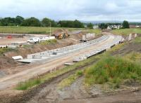 The Borders Railway station at Shawfair under construction on 27 June 2014. View south towards Sheriffhall from the new flyover, with road access and car parking to the left and Newton village in the right background. A 'new town' development is planned around this location.<br><br>[John Furnevel&nbsp;27/06/2014]