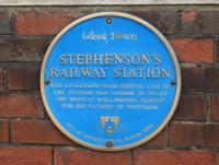 Blue plaque from the City of Salford at Eccles station. The plaque celebrates the opening of the station on the original Liverpool and Manchester Railway by the Duke of Wellington in 1830.<br><br>[John McIntyre&nbsp;19/04/2014]