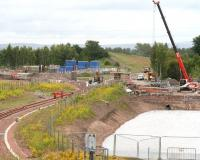 Borders Railway progress at the north end of Millerhill Yard on 26 June 2014.  View south west towards Shawfair, with a new bridge over the trackbed starting to take shape beyond the end of the turnback siding. The bridge will provide access from Whitehill Road into the new recycling plant which is being constructed here.<br><br>[John Furnevel&nbsp;26/06/2014]
