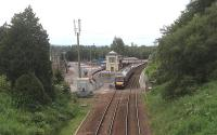 A northbound train heading through Gleneagles on 27 June, showing the new car park and station improvements made for the Ryder Cup golf tournament in September.<br><br>[John Robin&nbsp;27/06/2014]
