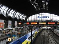The imposing train shed of Hamburg Hauptbahnhof shelters three very different trains on 11th June. To the right is a Deutsche Bahn IC (Intercity) service, while in the middle is a Metronom double-decker on regional duties - superficially the latter looks like a private operation, but the company is actually owned by the three German Laender (states) of Bremen, Hamburg and Niedersachsen. On the left Deutsche Bahn's 17.28 ICE (Intercity-Express) to Copenhagen is formed by a Class 605 high-speed tilting DMU.<br><br>[David Spaven&nbsp;11/06/2014]