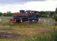 This 1929 Bagnall fireless locomotive was delivered new to Distillers, and later worked at Procter and Gamble. Since 2008, it has resided in a field adjacent to the Nuneaton-Leicester line, by Leicester Road, in Blaby. It was placed there by a local farmer to encourage the powers that be to reopen Blaby station, which closed in 1968. No luck so far.<br><br>[Ken Strachan 28/06/2014]