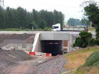 Almost back to normal at Sheriffhall on 27 June as a truck heads west over the new Borders Railway bridge towards Sheriffhall roundabout, with much of the abandoned diversionary route now removed. <br><br>[John Furnevel&nbsp;27/06/2014]