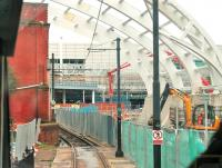 While Manchester Victoria's Metrolink area is being rebuilt there is temporary single line working through the area (and the tramstop is closed to passengers). This is the view over the driver's shoulder on a Bury bound tram showing the ongoing construction work as it passes the site of the famous <I>Hole in the wall</I>. [See image 33280] for the same location in 2011.<br><br>[Mark Bartlett&nbsp;09/06/2014]