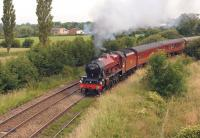 Ex LMS Jubilee 4-6-0 no. 45699 <I>Galatea</I> hauls the Wednesday <I>Fellsman</I> from Lancaster to Carlisle off the WCML at Farington Curve Jct on 2 July 2014 as it rounds the sweeping curve to join the East Lancs line towards Blackburn.<br><br>[John McIntyre&nbsp;02/07/2014]