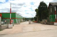 Entrance to the large works compound at Fountainhall on 30 June. View south from the site of the old level crossing with the station house, together with the remains of the down platform and water tower, on the right. [See image 6220] <br><br>[John Furnevel&nbsp;30/06/2014]