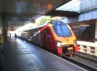 The 19.00 Virgin Trains London Euston - Wolverhampton pulls into Coventry on 6 July 2014. <br><br>[Ken Strachan&nbsp;06/07/2014]