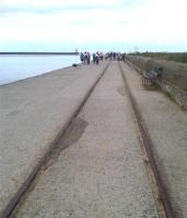 Long abandoned tracks running along South Shields south pier in 2014. Along the more landward half of the pier the track is laid level to the concrete surface, whereas on the seaward end the track stands some 20mm proud of the stone setts forming the surface up to the pier end lighthouse.<br><br>[David Pesterfield&nbsp;06/07/2014]