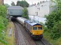 GBRf 66736 passes the surviving Edinburgh suburban Inner Circle platform at Morningside Road on 8 July with the 6S45 North Blyth - Fort William alumina train.<br><br>[Bill Roberton&nbsp;08/07/2014]