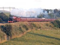 Just before the longest day of 2014 and there's plenty of evening sun to illuminate <I>Jubilee</I> 45699 <I>Galatea</I> and the returning <I>Fellsman</I> excursion as it passes Bay Horse near Lancaster.<br><br>[Mark Bartlett 18/06/2014]