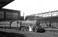 Holbeck Jubilee no 45697 <I>Achilles</I> stands at Carlisle on 7 August 1965. The locomotive is preparing to head home via the S&C with the summer Saturday 12.40pm Gourock - Leicester.<br><br>[K A Gray&nbsp;07/08/1965]