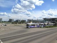 Southern terminus (and a transport interchange) of the 21km Edmonton LRT system is Century Park. This half barrier crossing just outside the station is one of many in the area crossing major and minor roads alike. With a frequent service of articulated trains on the LRT the barriers are often down against motorists and pedestrians but only for short periods. <br><br>[Malcolm Chattwood&nbsp;13/06/2014]