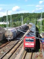 On 13th June the 16.42 Stralsund-Ostseebad Binz IC service passes a rake of aggregates wagons at Bergen auf Ruegen. Although primarily a holiday island, rail freight is still generated on Ruegen by the massive Sassnitz Mukran ferry complex where train ferries operate to Lithuania, Russia and Sweden.<br><br>[David Spaven&nbsp;13/06/2014]