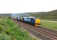 DRS liveried 37259 and 37610 <I>'T S (Ted) Cassady 14.5.61-6.4.08'</I>, growl up the gradient south of Dalnaspidal on 30 June with a train of ten autoballasters for engineering works at Achnasheen.<br><br>[John Gray&nbsp;30/06/2014]
