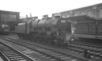 Waiting patiently at Carlisle station on Saturday 17 August 1963 is Crewe North based Royal Scot no 46155 <I>The Lancer</I>. The locomotive is diagrammed to take over a relief Perth - Euston train.<br><br>[K A Gray&nbsp;17/08/1963]