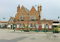 The very tidy exterior of Lymington Town station building seen from the forecourt. This staffed station is operated by South West Trains and enjoys a 30 minute frequency service seven days a week.<br><br>[Mark Bartlett&nbsp;20/05/2014]