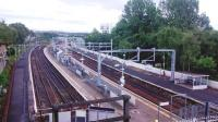 View south over the fully electrified Springburn Station on 12 July 2014.<br><br>[Colin Harkins&nbsp;12/07/2014]