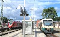 On 13th June, at the Bergen auf Ruegen junction, a single-car Pressnitztalbahn train forms the 17.40 service over the 12.5km branch to Lauterbach Mole, while to the left an EMU operates the 17.07 Ostseebad Binz to Stralsund RE (Regional Express) service. With the exception of the Lauterbach branch, all standard-gauge passenger services on Ruegen are electric.<br><br>[David Spaven&nbsp;13/06/2014]