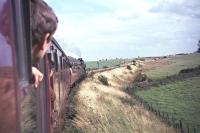 Photograph taken during the <I>Fife Coast Railtour</I> on 28 August 1965. The special, which started from St Enoch behind no 256 <I>Glen Douglas</I>, was handed over to J37 0-6-0 no 64569 at Leuchars Junction for the trip around the coast. The train is seen here near Anstruther on its way to Thornton Junction. [Ref query 6785] <br><br>[G W Robin&nbsp;28/08/1965]