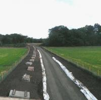 View south at Arniston towards Gorebridge on 15 May 2014, with sleepers awaiting tracklaying.<br><br>[John Yellowlees 15/07/2014]