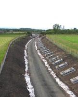 Track laying imminent at Arniston, between Newtongrange and Gorebridge, looking north towards Lady Victoria on 15th July 2014.<br><br>[David Spaven 15/07/2014]