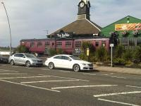 A Mark 1 carriage outside <I>The Rattler</I> Bar and Restaurant alongside the coast road at Marsden, South Shields, in July 2014. Named after <I>The Marsden Rattler</I> - the line opened by the Whitburn Coal Company from South Shields (Westoe Lane) to Whitburn Colliery in 1879 - which roughly followed the route of the current road. The line closed to passengers in 1953, but continued to transport coal until the pit closed in 1968.<br><br>[David Pesterfield&nbsp;06/07/2014]