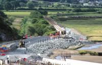 The realignment of the track for the replacement Pont Briwet has (temporarily) obliterated Llandecwyn halt, seen here on 6 July 2014. As the area is part of Snowdonia National park, care is being taken to build the boundary walls with local materials.<br><br>[Colin McDonald&nbsp;06/07/2014]