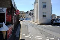 View along Custom House Quay, Weymouth, showing part of the line running through the streets to the south of the current Weymouth terminus to reach Weymouth Quay. Still in situ on 17 July 2014 but not in use. [See image 44106]<br><br>[Peter Todd&nbsp;17/07/2014]