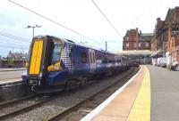 The stock for the 11.36 all-stations to Glasgow stands in platform 2 at Ayr station on 18 July (journey time 60 minutes). Platform 1 will shortly be occupied by the 10.30 from Glasgow which will return as the 11.23 fast service (journey time 49 minutes).<br><br>[Colin Miller&nbsp;18/07/2014]