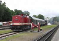 By sheer coincidence (honestly!) the photographer found that his holiday in Putbus on the island of Ruegen concided with the 14th and 15th June annual Putbus Railfest. On 14th June, ex Deutsche Reichsbahn (DR) Class 112 diesel and Class 52 steam locos prepare to operate the first Plandampf train of the day to Bergen auf Ruegen, substituting for the normal diesel unit service. The Plandampf is a common sight in Germany, with heritage locomotives taking over normal timetabled services - a lesson perhaps for the Borders Railway?<br><br>[David Spaven&nbsp;14/06/2014]