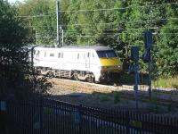 91107 starts out on time at 08.03 from platform 2 at Wakefield Westgate on the final leg of its journey from Kings Cross to Leeds on 14 July. Photographed from the new multi storey car park. <br><br>[David Pesterfield&nbsp;14/07/2014]