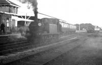 A smokescreen descends over Hayling Island station on 30 October 1962 as LBSCR <I>Terrier</I> 0-6-0T no 32650 runs round the branch train from Havant. The 1876 veteran (which hauled the last scheduled BR service over the branch on 3 November 1963) survives in preservation. <br><br>[K A Gray&nbsp;30/10/1962]